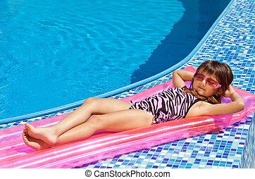little girl on a mattress
