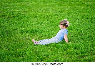 Little girl on a meadow