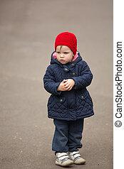 little girl on a park alley
