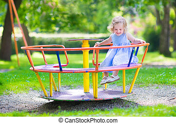 Little girl on a playground - Happy laughing child,...