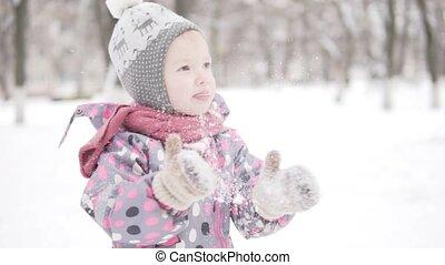 Little girl on a walk in the winter