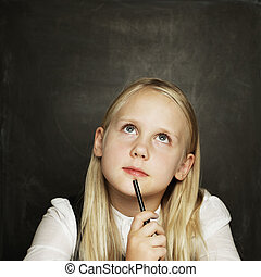 Little girl on blackboard background