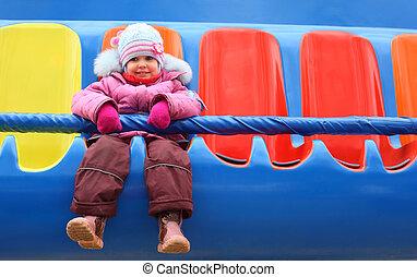little girl on carousel
