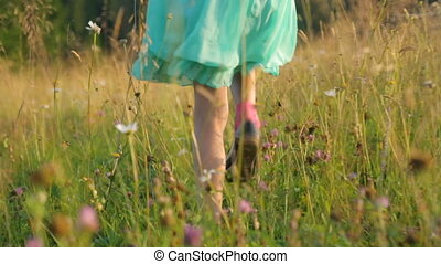 Little girl on field in summer