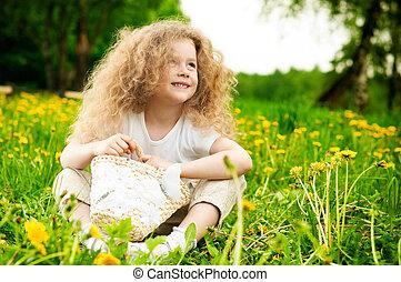 little girl on flower field