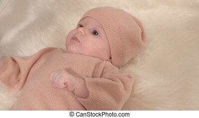Little girl on fur cloth