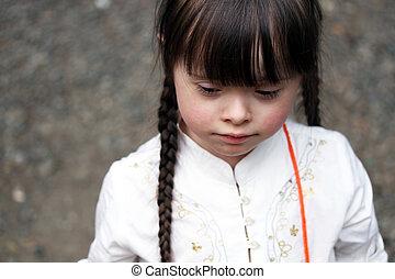 Little girl on grey background
