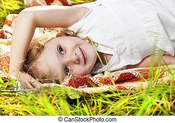 Little girl on meadow.
