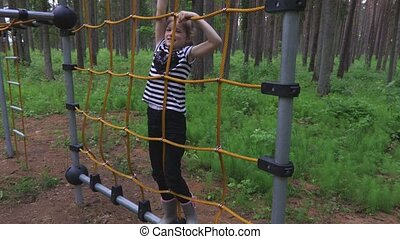 Little girl on obstacle course