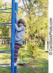 little girl on park playground