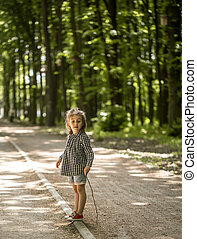 little girl on path in woods