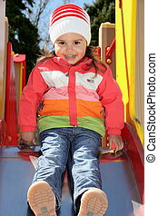 Little Girl on Playground Ready to Slide