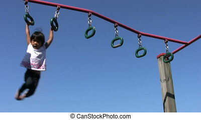 Little Girl On Playground Rings