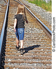 little girl on railroad track