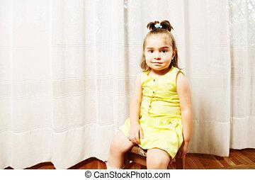 Little girl on stool