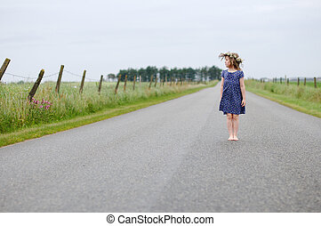 Little girl on the country road