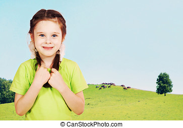 Little girl on the green hills in sunny day