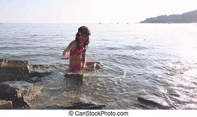 Little girl on the sea. Girl teenager bathing in sea happy childhood and dreams water