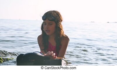 Little girl on the sea. Girl teenager bathing in sea water happy childhood and dreams