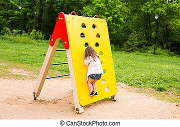 little girl on the summer playground