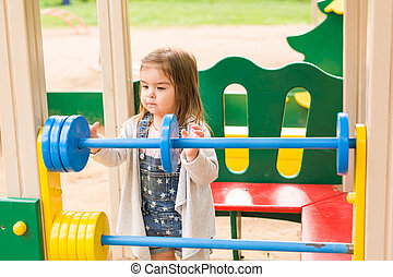 little girl on the summer playground