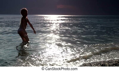 little girl on the sunset beach