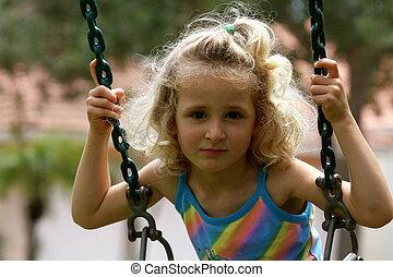 Little girl on the swing