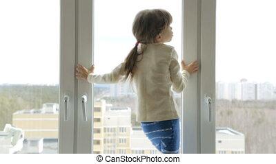 Little girl on the windowsill