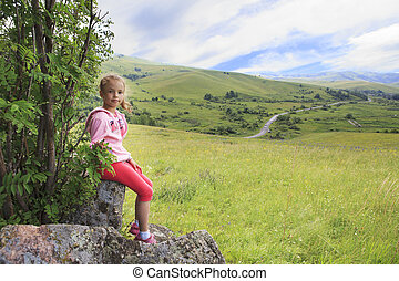 Little girl on top of the Altai Mountains.