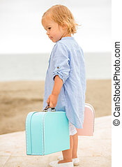 Little girl on vacation at the seaside