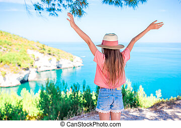Little girl on vacation travel background beautiful landscape