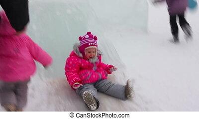 little girl on winter ice slide