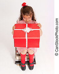Little girl opening a present