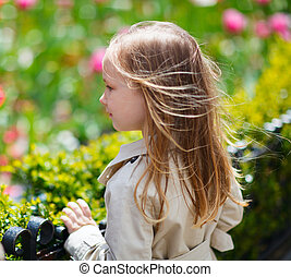 Little girl outdoors on spring day