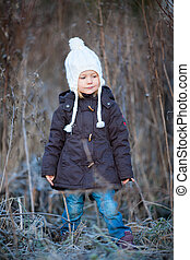 Little girl outdoors on winter day