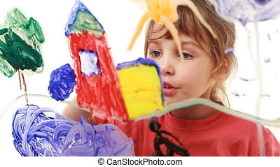 Little girl paint window house in picture on transparent glass