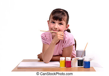 Little girl painting a picture with colorful paints