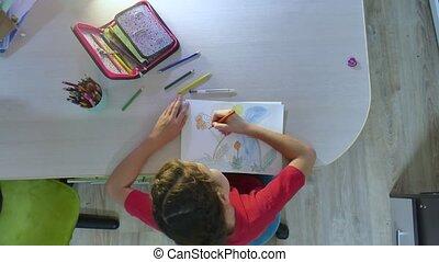 Little girl painting at paint table . schoolgirls girl...