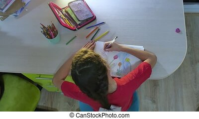 Little girl painting at table paint. schoolgirls girl...