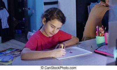 Little girl painting at table. schoolgirls girl teenager...