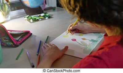Little girl painting at table. schoolgirls girl teenager the...