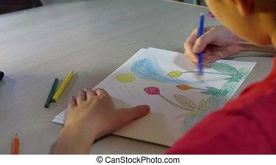 Little girl painting at table. schoolgirls girl paint...