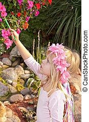 little girl painting flower