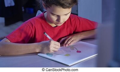 Little girl painting indoors at table. schoolgirls girl...