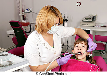 little girl patient and female dentist