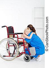little girl patient hugging doctor