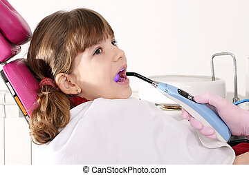 little girl patient in dentist office