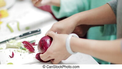 Little girl Peeling a red Onion - Close up shot of a little...
