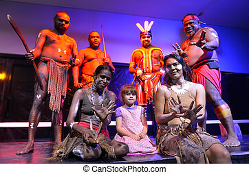 Little girl (age 05) photographed with Native Australian Yirrganydji Aboriginal people during cultural show in Queensland, Australia