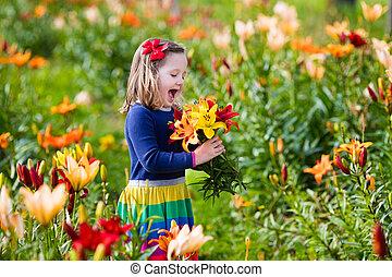 Little girl picking lilly flowers - Cute little girl picking...